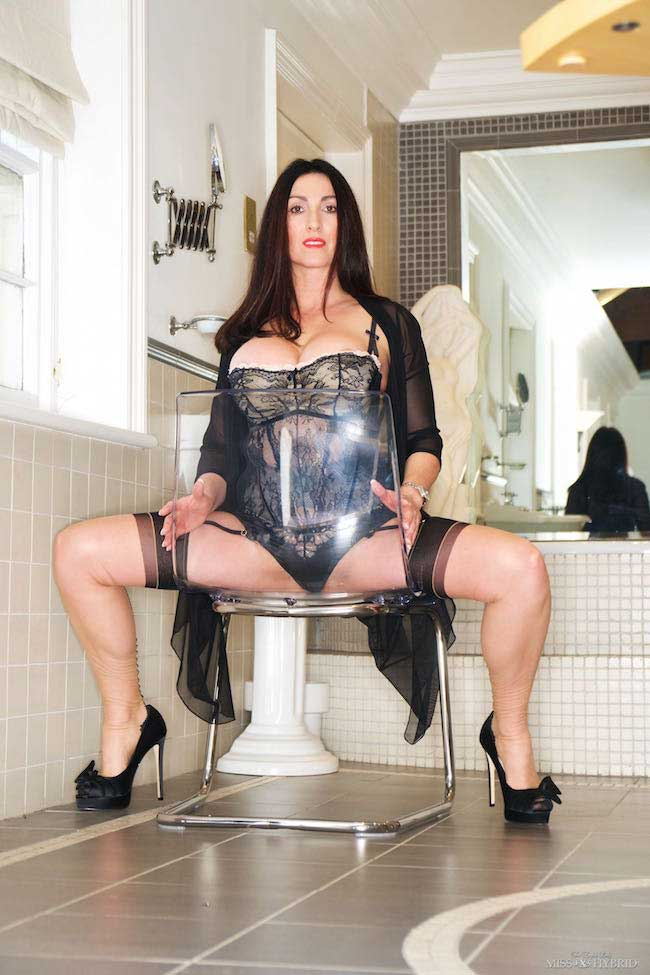 Miss Hybrid perspex chair flashing pussy and tits in stunning lingerie and seamed stockings.