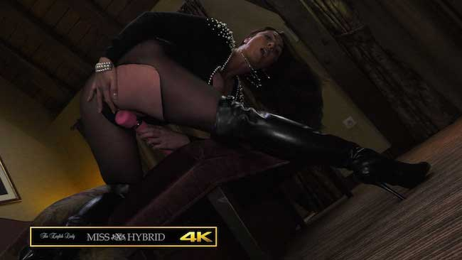 Leather thigh boots mistress Miss Hybrid rubs her wet pussy with the magic wand.