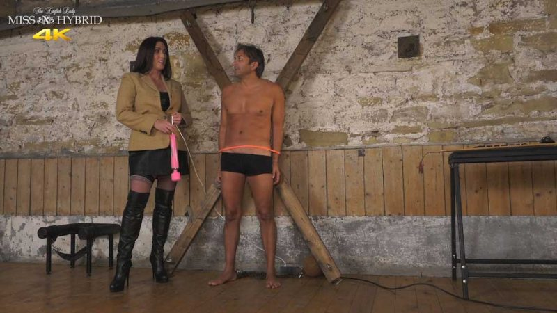 Miss Hybrid sexy leather boots and stocking tops in the Manor dungeon.